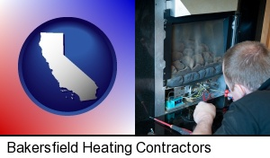 Bakersfield, California - a heating contractor servicing a gas fireplace
