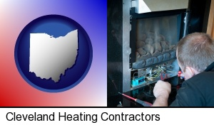 Cleveland, Ohio - a heating contractor servicing a gas fireplace