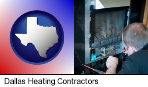 Dallas, Texas - a heating contractor servicing a gas fireplace