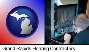 a heating contractor servicing a gas fireplace in Grand Rapids, MI