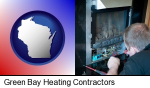 Green Bay, Wisconsin - a heating contractor servicing a gas fireplace