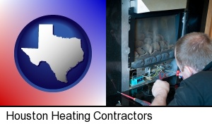 Houston, Texas - a heating contractor servicing a gas fireplace