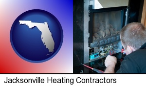 Jacksonville, Florida - a heating contractor servicing a gas fireplace