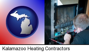 Kalamazoo, Michigan - a heating contractor servicing a gas fireplace