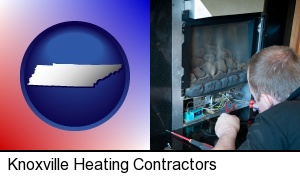 Knoxville, Tennessee - a heating contractor servicing a gas fireplace