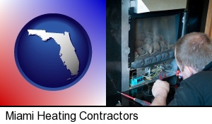 Miami, Florida - a heating contractor servicing a gas fireplace