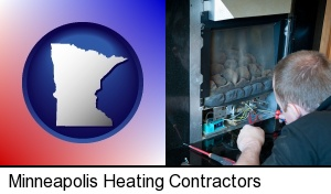 Minneapolis, Minnesota - a heating contractor servicing a gas fireplace