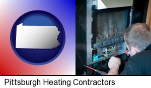 a heating contractor servicing a gas fireplace in Pittsburgh, PA
