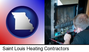 Saint Louis, Missouri - a heating contractor servicing a gas fireplace