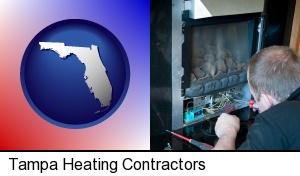 Tampa, Florida - a heating contractor servicing a gas fireplace