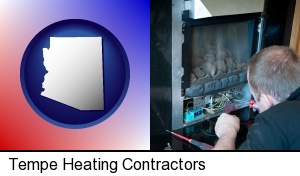 a heating contractor servicing a gas fireplace in Tempe, AZ