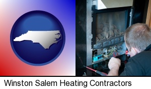 a heating contractor servicing a gas fireplace in Winston Salem, NC