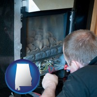 alabama a heating contractor servicing a gas fireplace