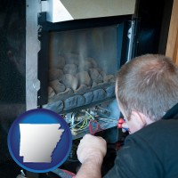 arkansas a heating contractor servicing a gas fireplace