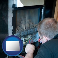 colorado a heating contractor servicing a gas fireplace