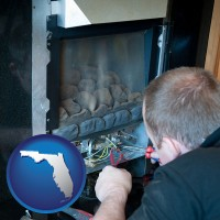 florida map icon and a heating contractor servicing a gas fireplace