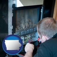 iowa a heating contractor servicing a gas fireplace