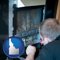 idaho map icon and a heating contractor servicing a gas fireplace