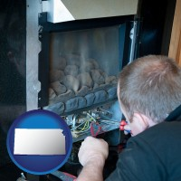 kansas a heating contractor servicing a gas fireplace