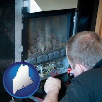 maine a heating contractor servicing a gas fireplace