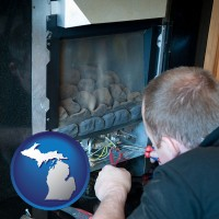 michigan a heating contractor servicing a gas fireplace