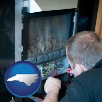 north-carolina a heating contractor servicing a gas fireplace
