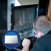north-dakota a heating contractor servicing a gas fireplace