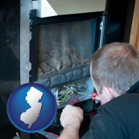 new-jersey map icon and a heating contractor servicing a gas fireplace