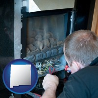 new-mexico a heating contractor servicing a gas fireplace