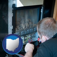 ohio a heating contractor servicing a gas fireplace