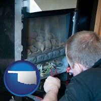 oklahoma map icon and a heating contractor servicing a gas fireplace