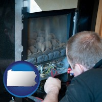 pennsylvania a heating contractor servicing a gas fireplace