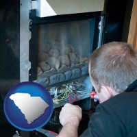 south-carolina a heating contractor servicing a gas fireplace