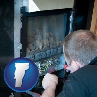 vermont map icon and a heating contractor servicing a gas fireplace