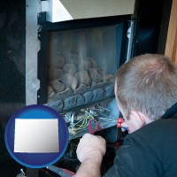 wyoming map icon and a heating contractor servicing a gas fireplace