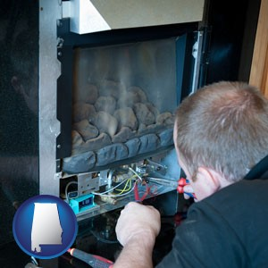 a heating contractor servicing a gas fireplace - with Alabama icon