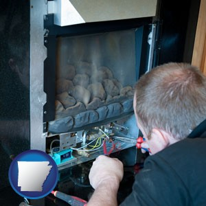a heating contractor servicing a gas fireplace - with Arkansas icon