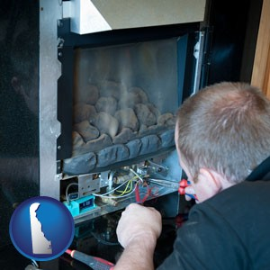 a heating contractor servicing a gas fireplace - with Delaware icon