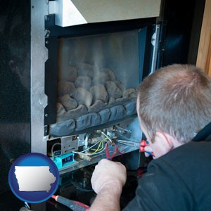 a heating contractor servicing a gas fireplace - with Iowa icon