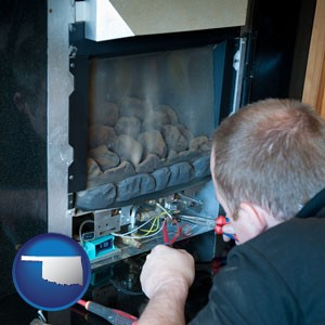a heating contractor servicing a gas fireplace - with Oklahoma icon
